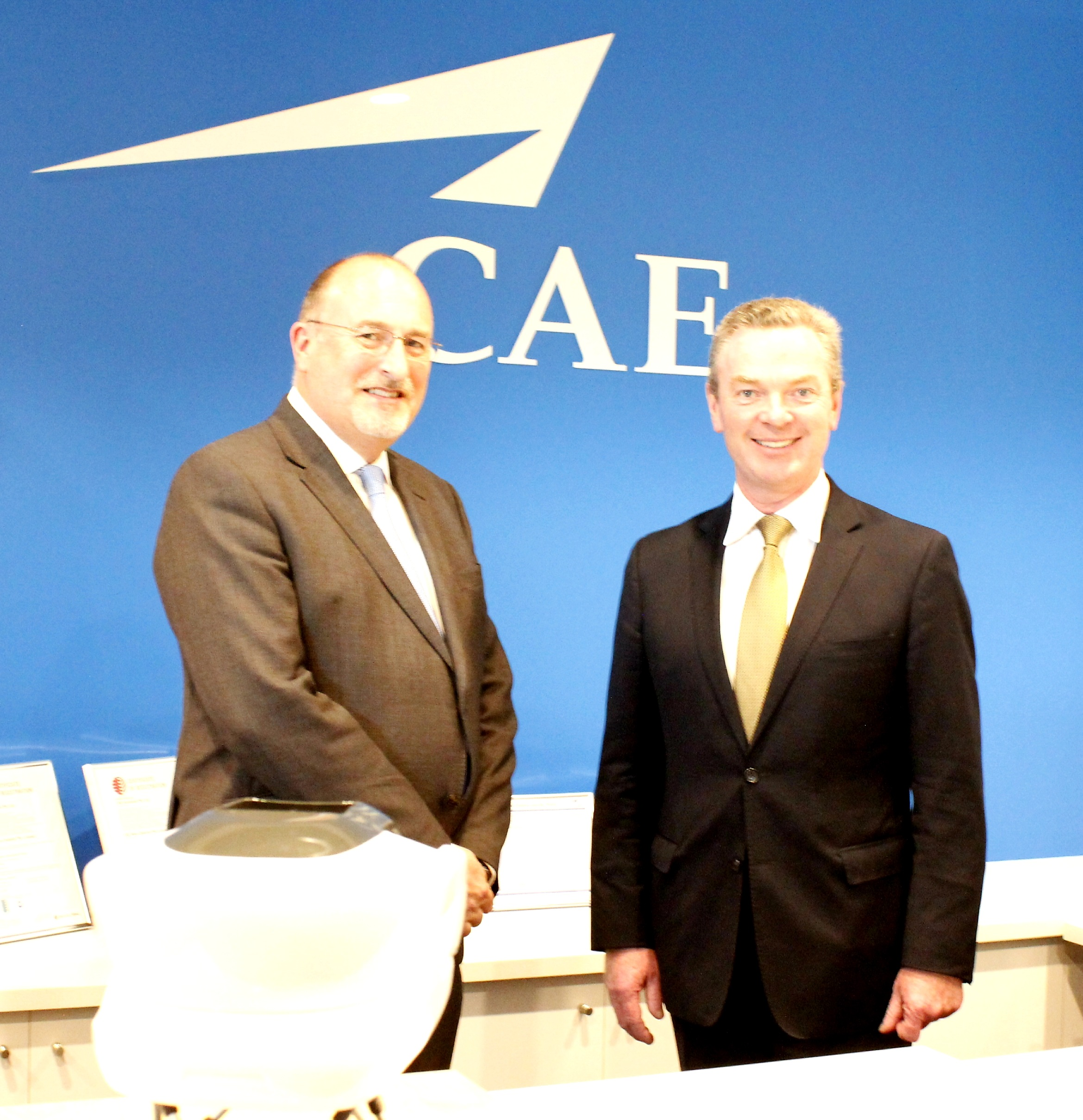 b0a9b718f2a Ian Bell (left), CAE's Vice President & General Manager,  Asia-Pacific/Middle East was joined by the Hon Christopher Pyne (right),  Australia's Minister for ...