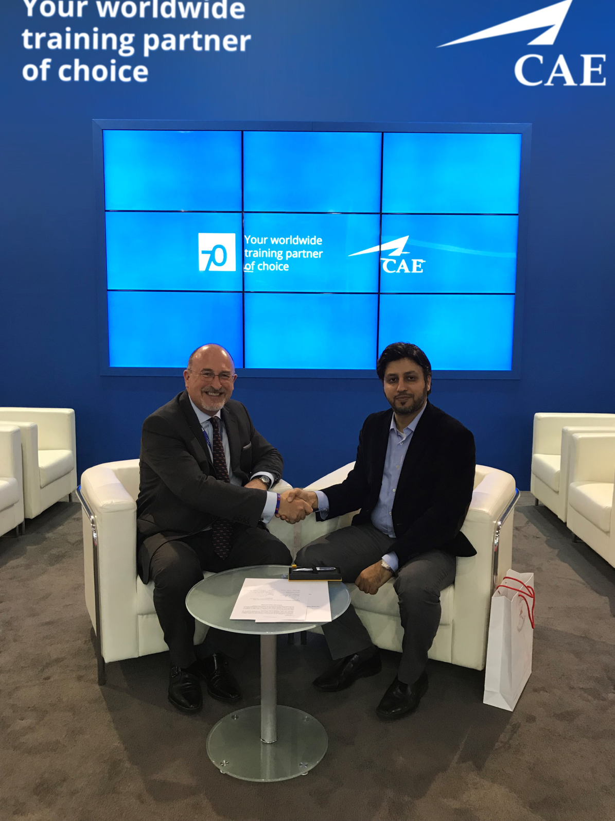 Ian Bell, CAE (left) and Dr. Dhafir Awadh Al Shanfari, OAPFD (right) celebrate the signing of an agr
